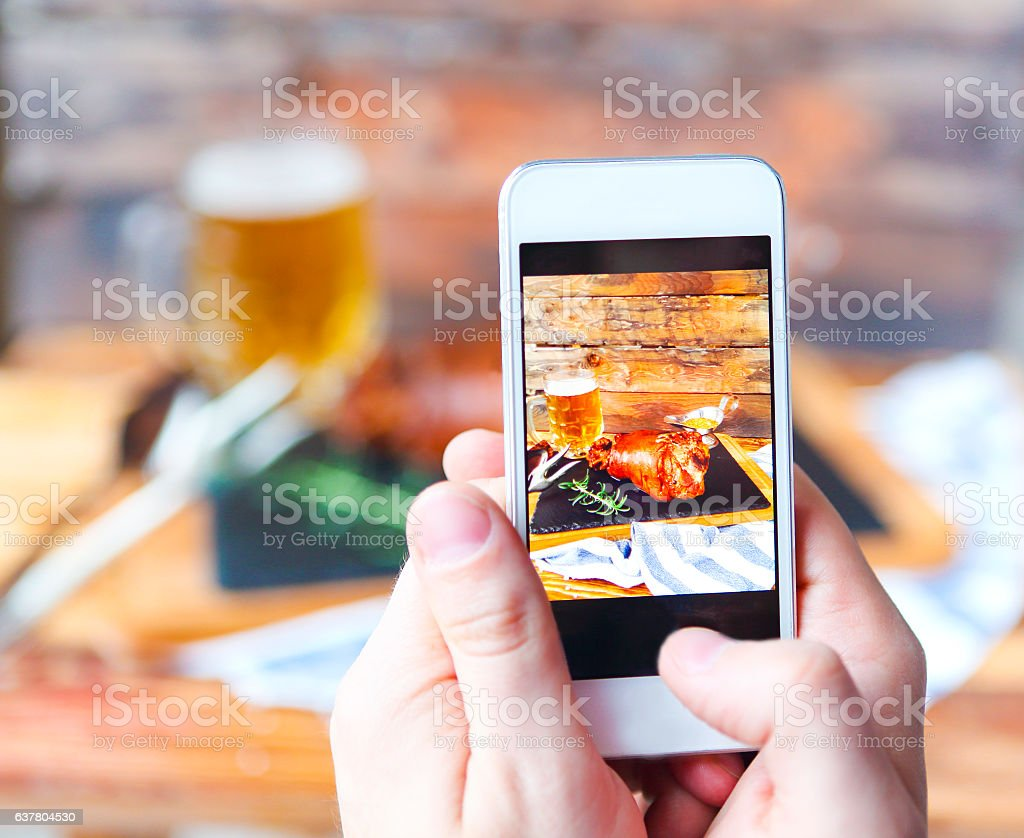 Photo  of roasted pork leg on the wooden table stock photo