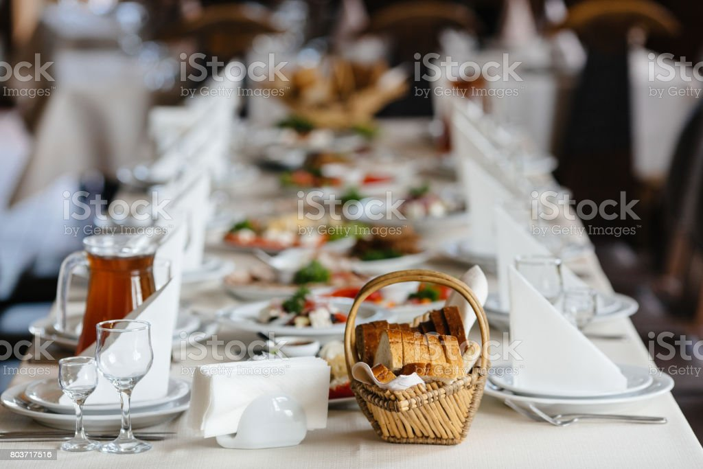 Photo of festive table with dishes and cutlery