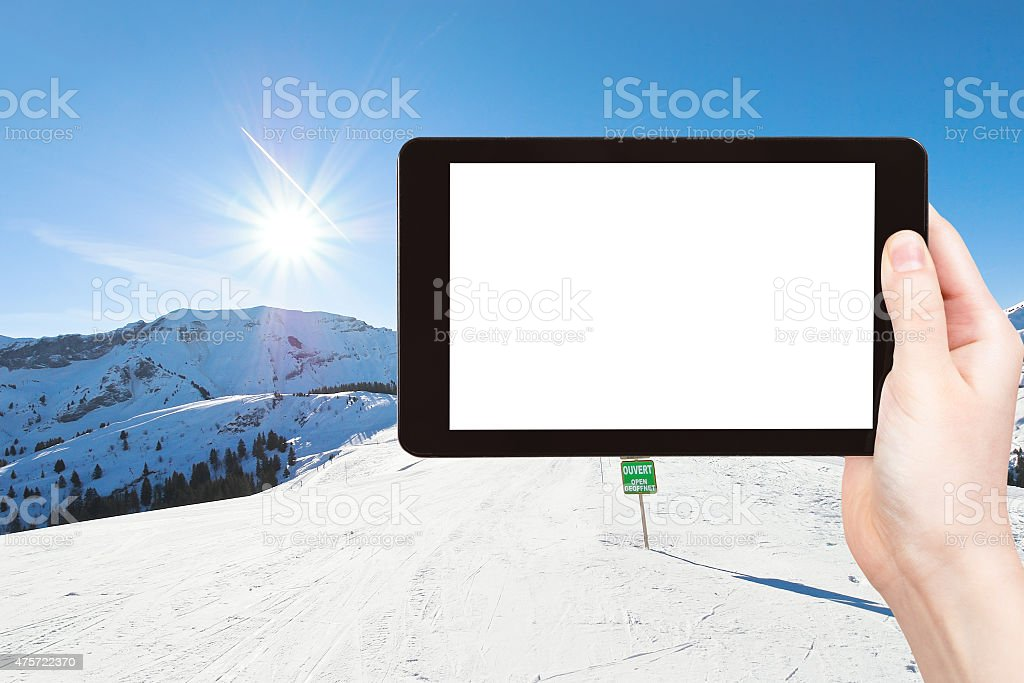 photo of skiing tracks on snow slopes in sunny day stock photo