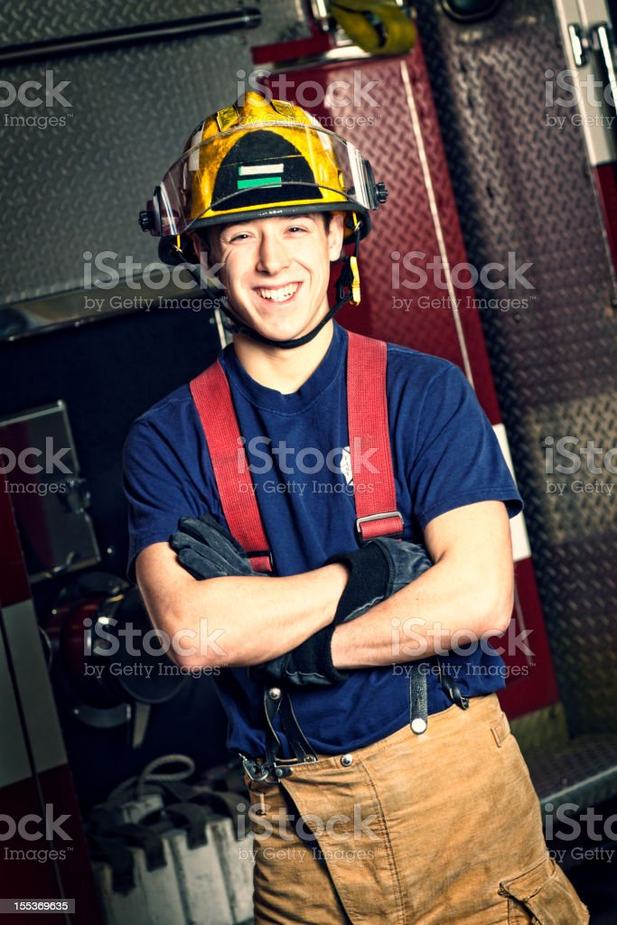 Photo of smiling firefighter cadet with red suspenders royalty-free stock photo