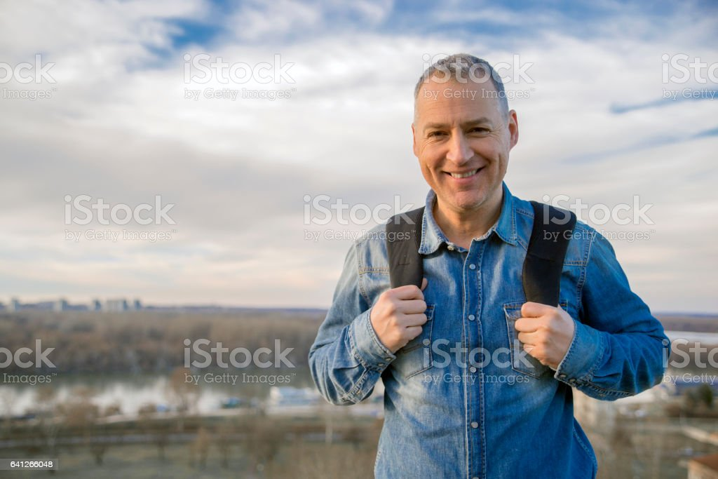 Photo of Smiling mature man looking at camera in nature stock photo