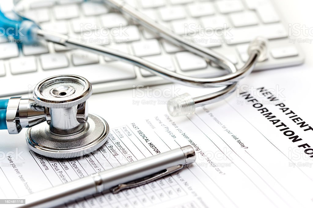 Photo of stethoscope, keyboard and patient record stock photo