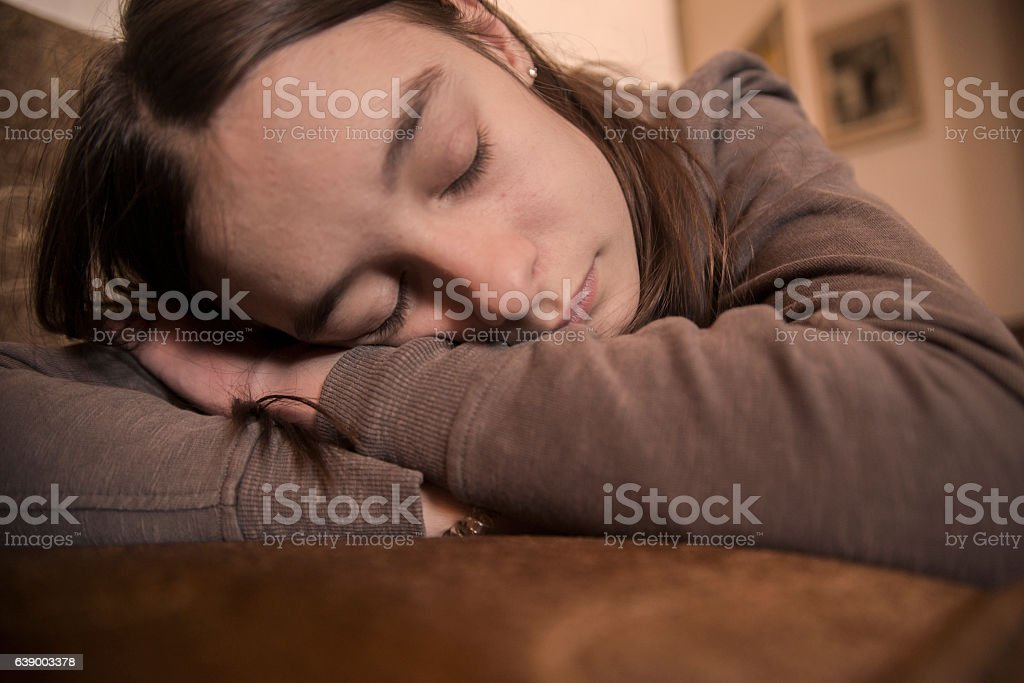 Photo of Teen resting peacefully in bed stock photo