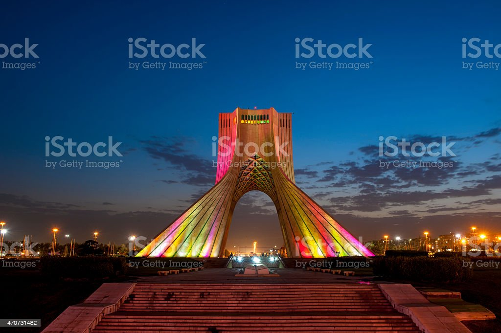 Photo of the Azadi Tower in Iran lit up at night stock photo