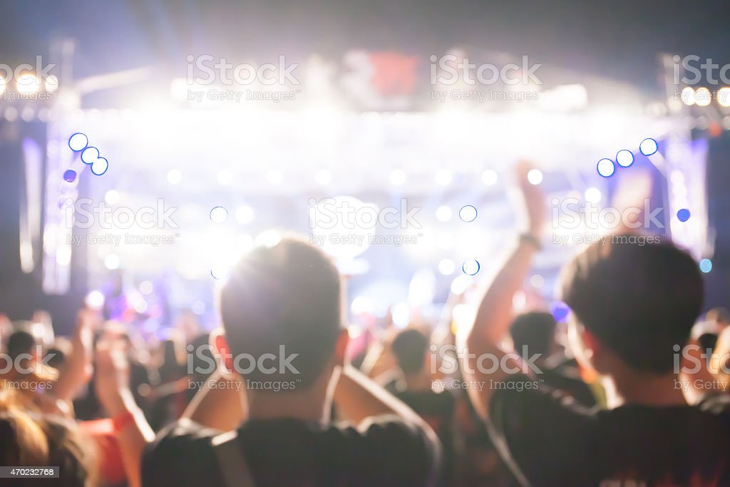 Photo of the crowd at a music concert that is out of focus stock photo