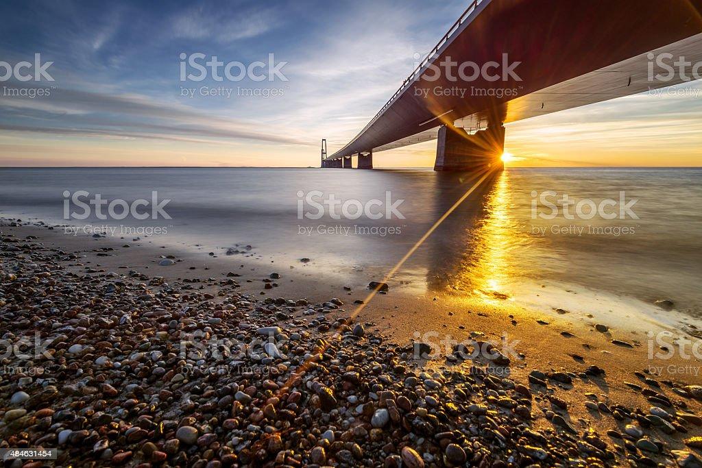 Photo of the Danish Great Belt Bridge at sunset stock photo
