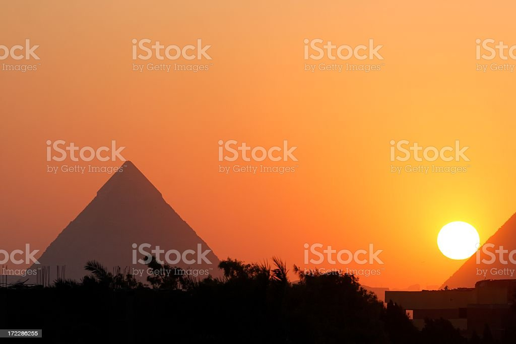 Photo of the Giza pyramids, Egypt, in the sunset stock photo