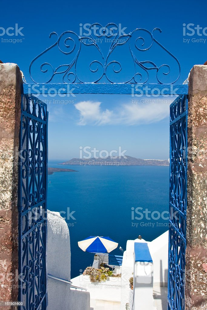 Photo of the ocean through a blue gate  royalty-free stock photo