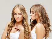 Photo of two beautiful girls on a gray background