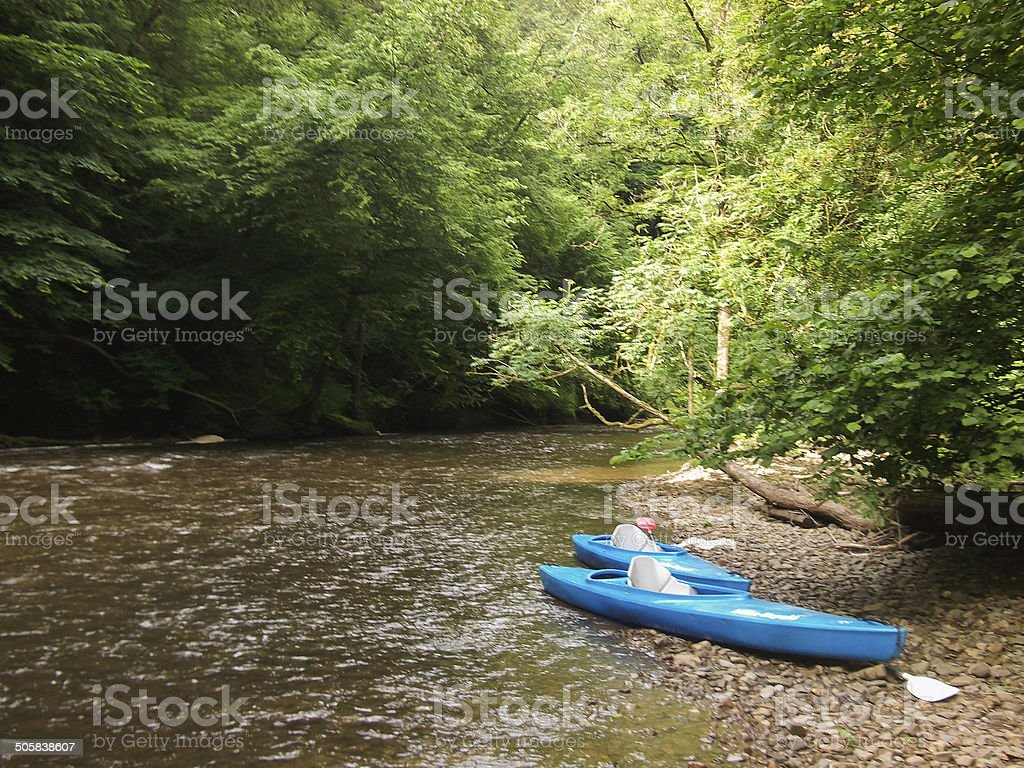 Photo of two blue Kayaks on La Lesse riverbank Ardenne stock photo