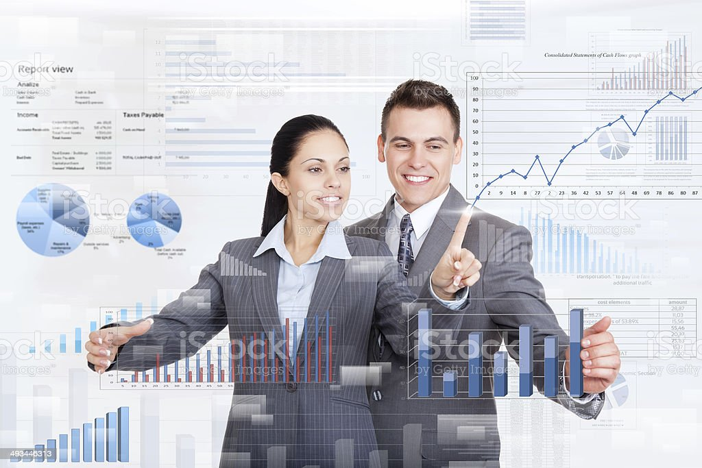 Photo of two business people and a finance chart stock photo