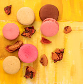 Photo of vibrant macarons with crumbs and copyspace