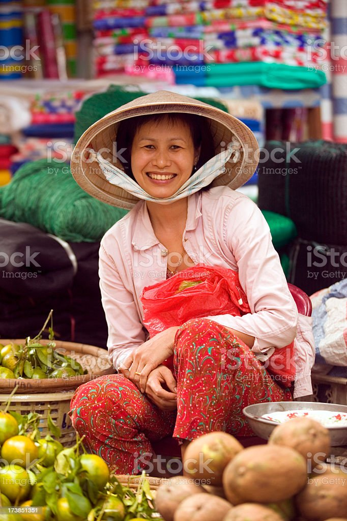 Photo of Vietnamese woman selling vegetables at market stock photo