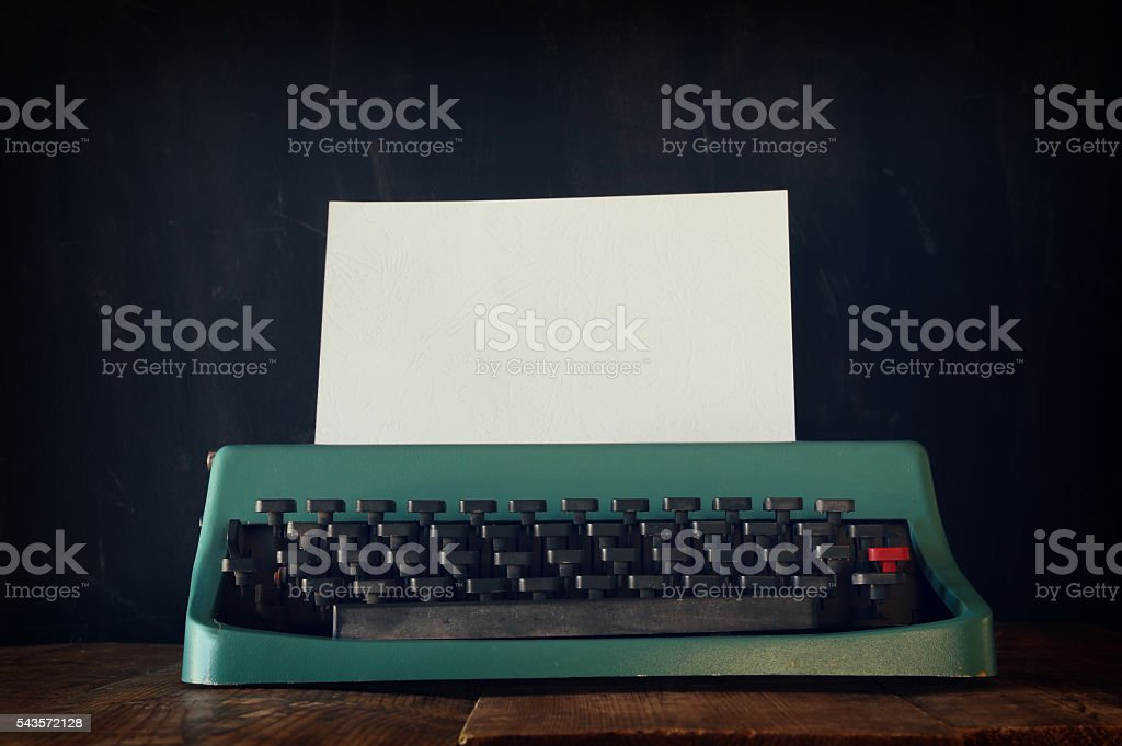 Photo of vintage typewriter with blank page stock photo