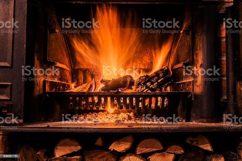 Photo of Warm Fireplace as a piece of furniture stock photo