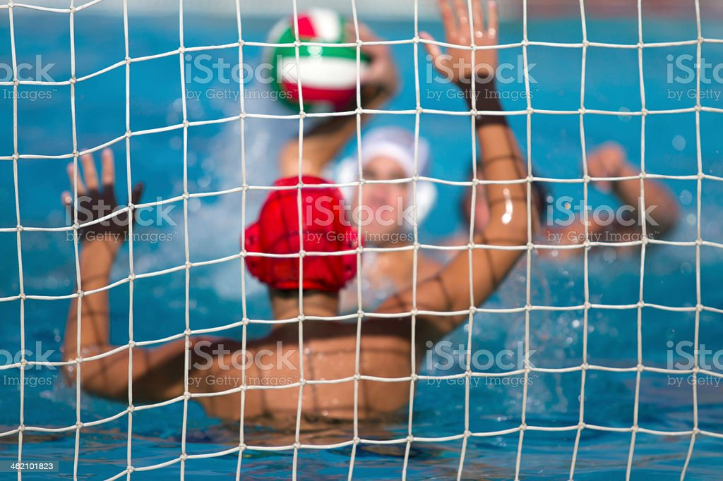 Photo of water polo game taken from behind goal keeper stock photo
