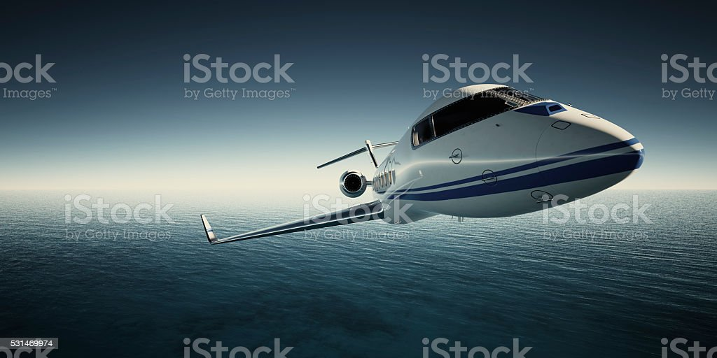 Photo of White Luxury Generic Design Private Jet Flying in stock photo