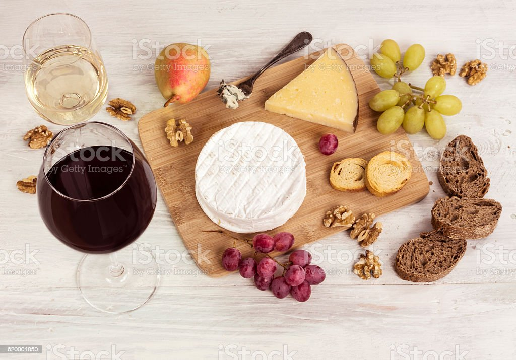 Photo of wine tasting with various cheeses and grapes stock photo
