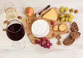 Photo of wine tasting with various cheeses and grapes