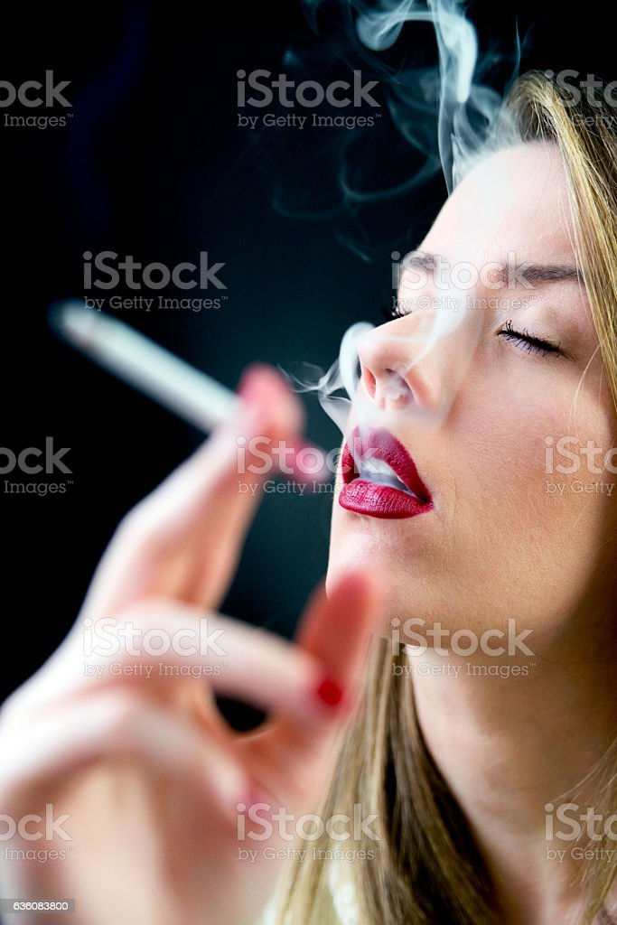 Photo of Woman enjoying her cigarette in the morning stock photo