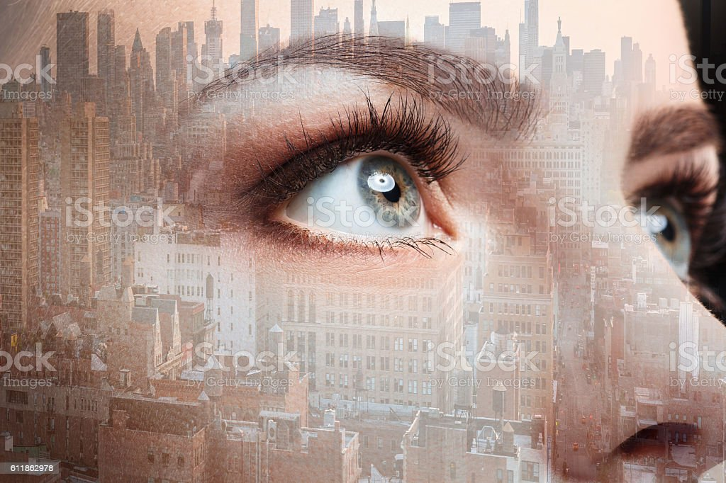Photo of woman eye and business city. Double exposure stock photo