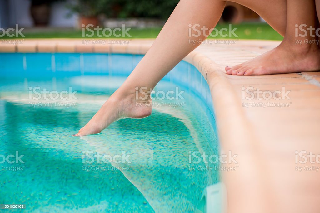 Photo of woman Getting a feel for the water stock photo