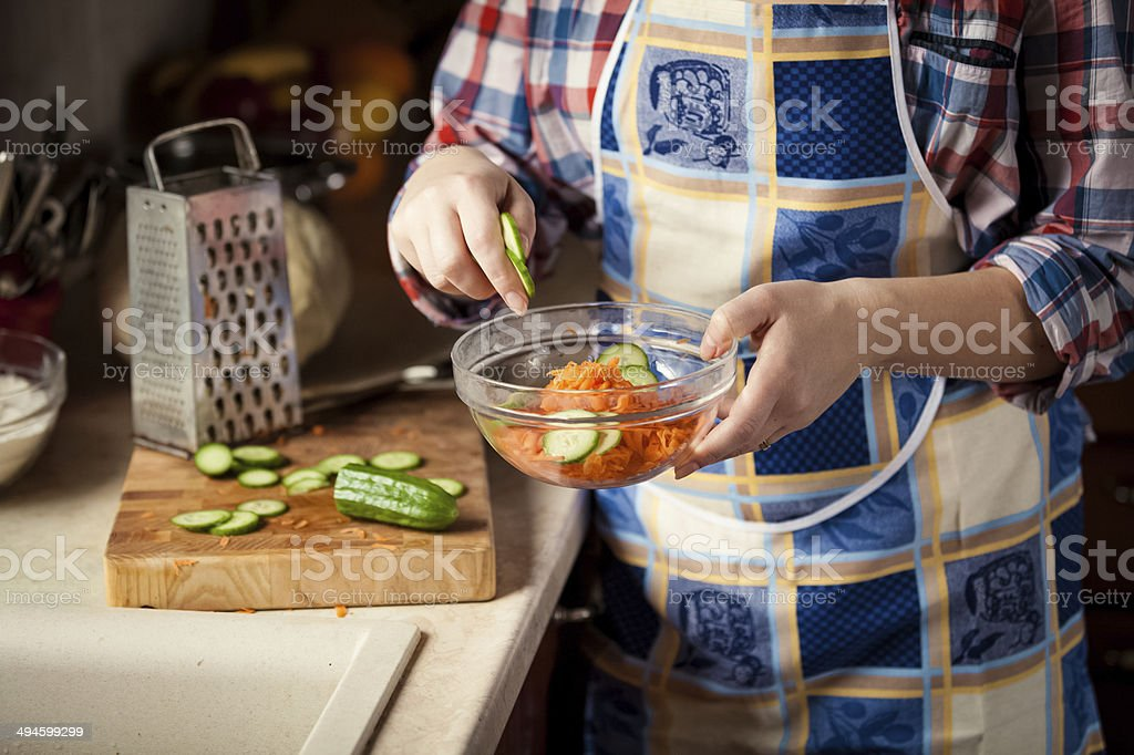 photo of woman mixing salad in glass bowl royalty-free stock photo