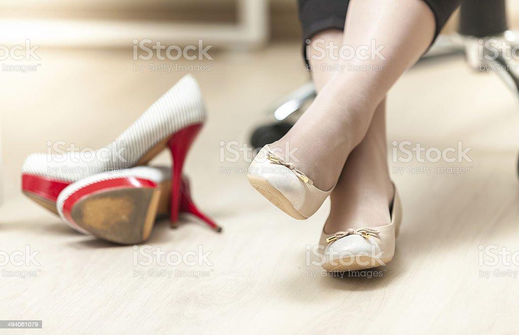 photo of woman wearing ballet flats instead of high heels stock photo