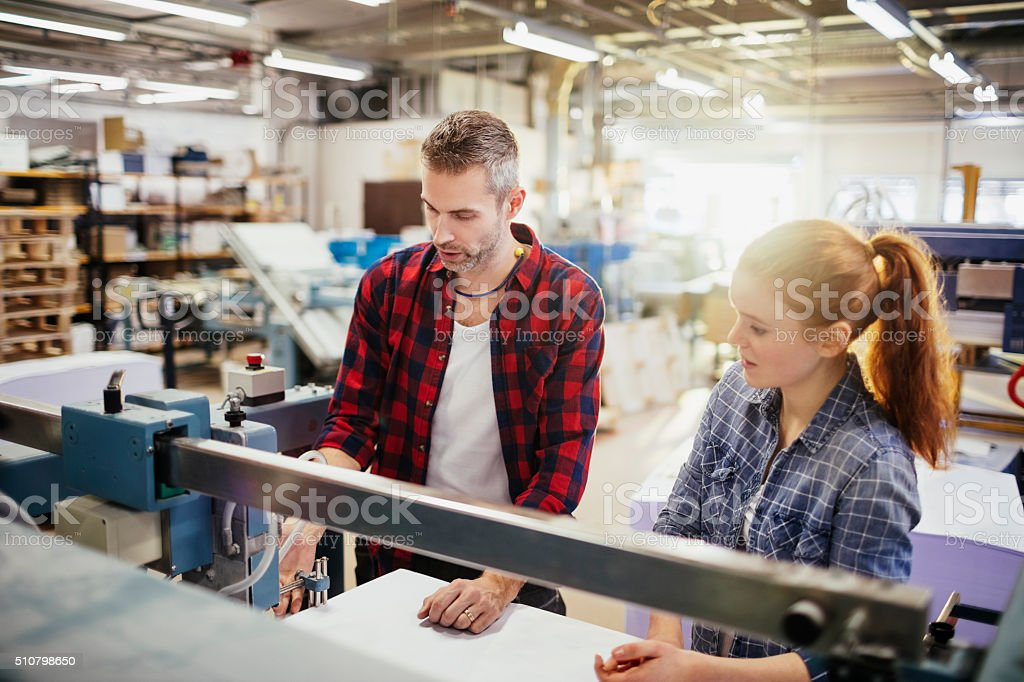 Photo of workers in printing factory stock photo