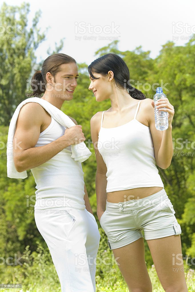 Photo of young couple at outdoors workout together royalty-free stock photo