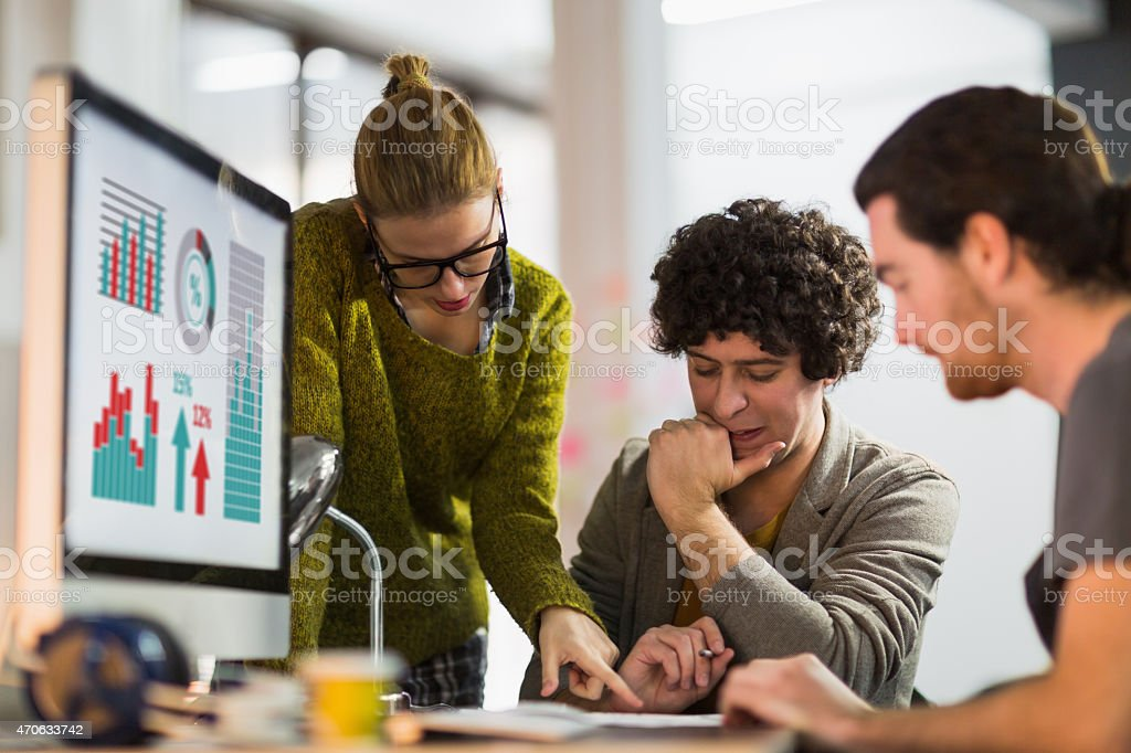 Photo of young freelance designers working in office stock photo