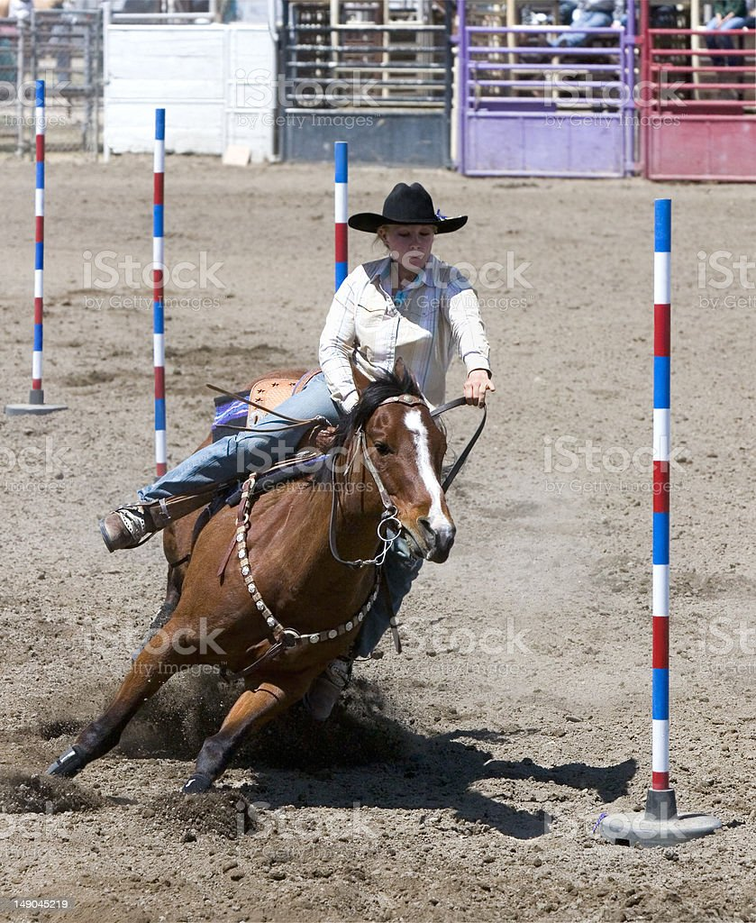 Photo Rodeo Cow-Girl Pole Bending Competition Horse royalty-free stock photo