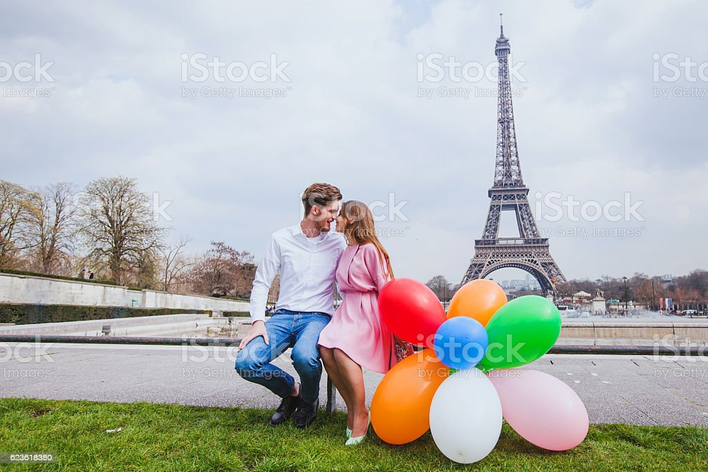 photo shoot, happy couple with balloons in Paris stock photo