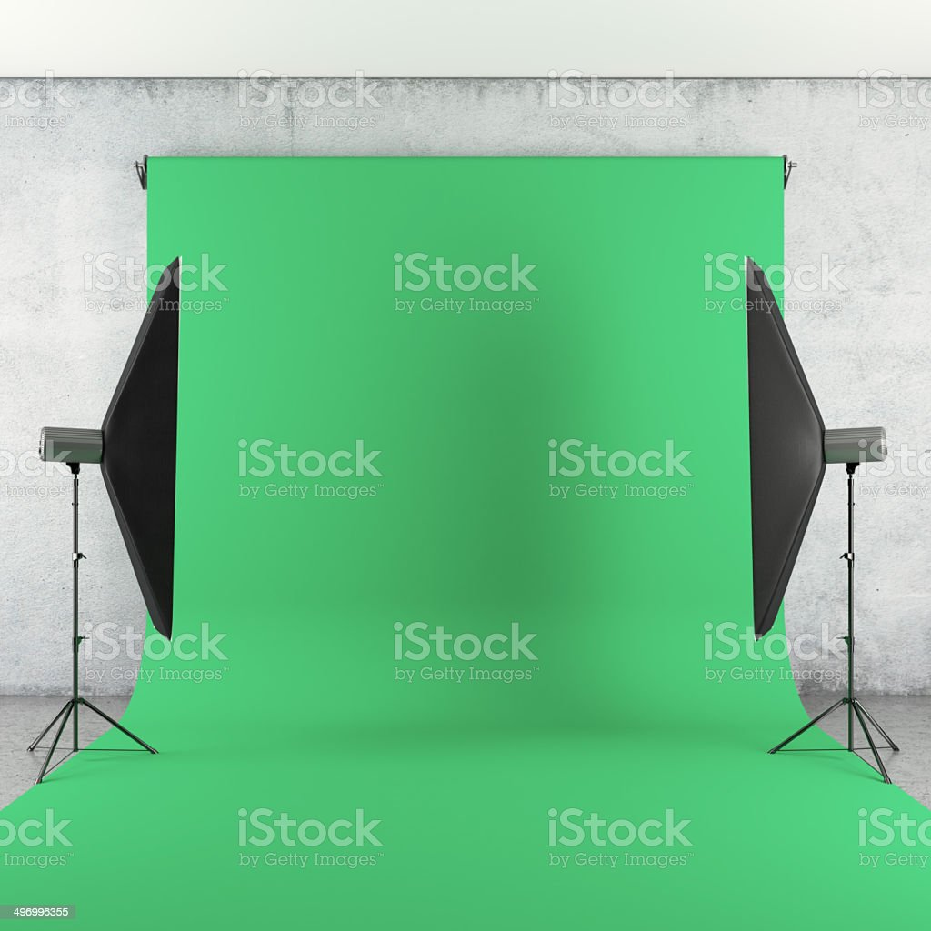 Photo Studio with Lights and Green Backdrop stock photo