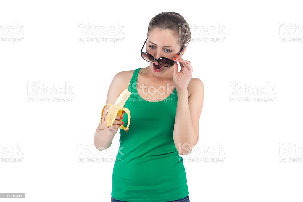 Photo surprised woman with banana and sunglasses stock photo