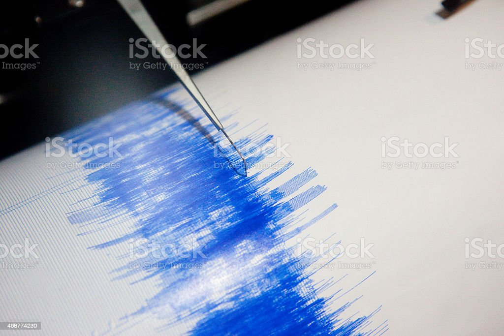 Photo up close of earthquake seismograph in action  stock photo