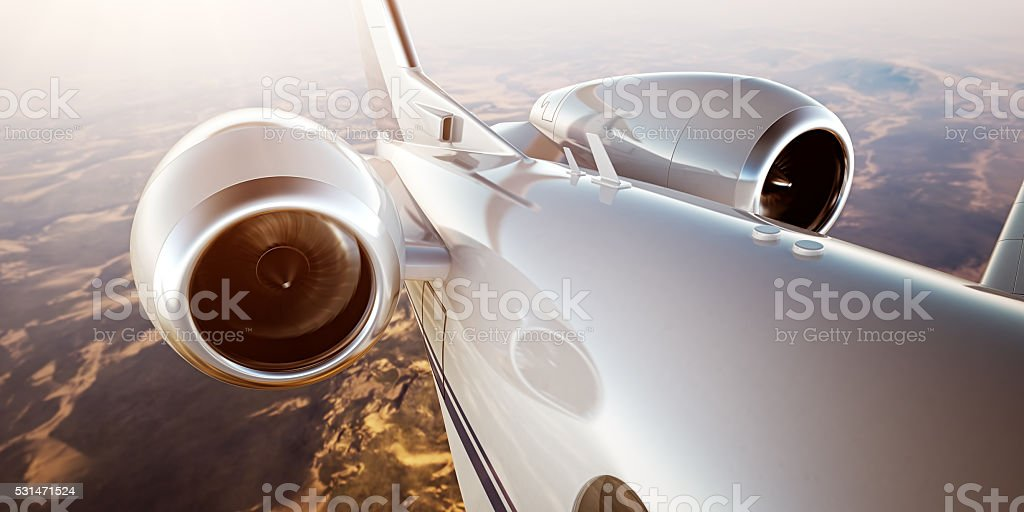 Photo White Luxury Generic Design Private Jet Flying in Blue stock photo