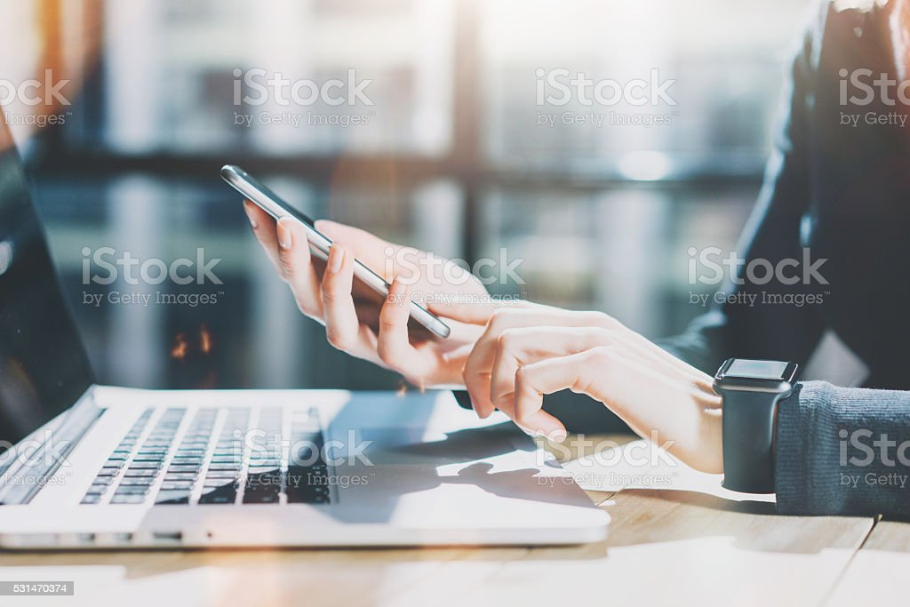 Photo Woman Working Modern Smartphone and Wearing Generic Design Smart stock photo