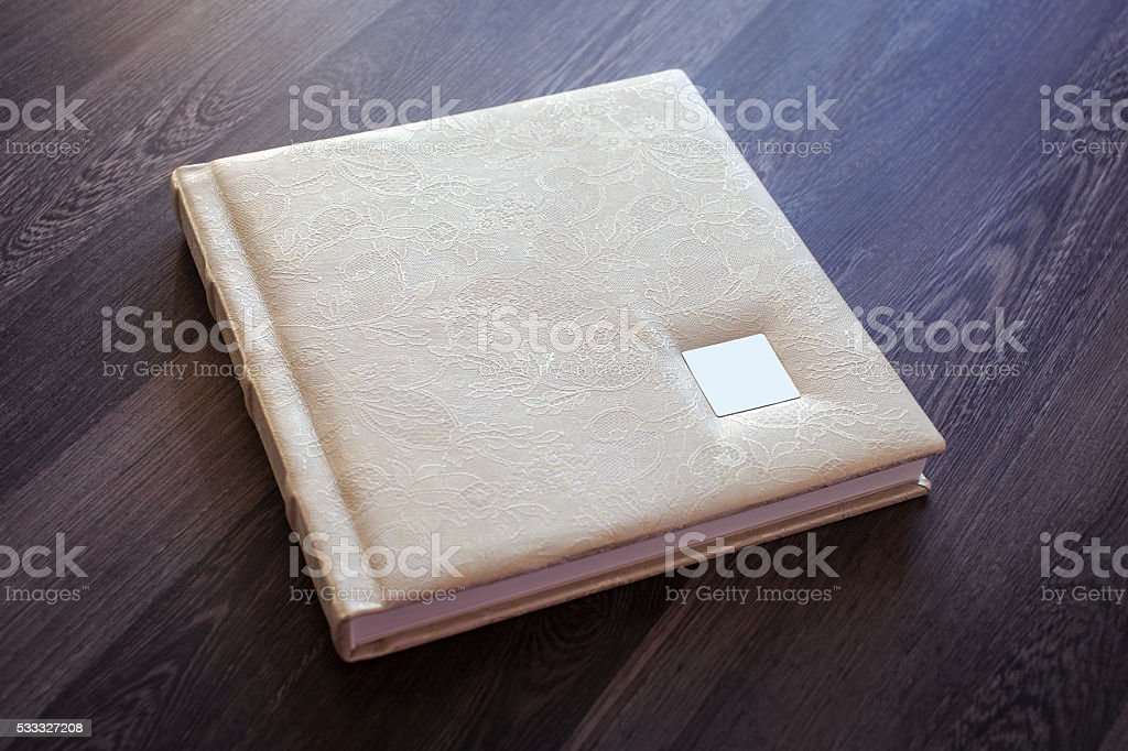 Photobook with a cover of genuine leather stock photo