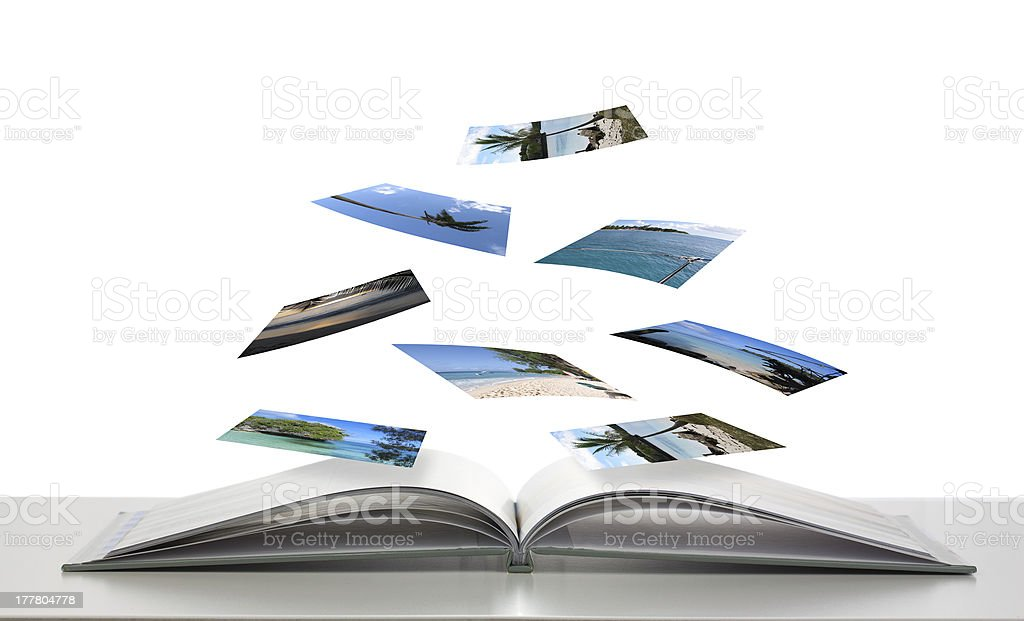 Photobook with Photos of Beach Scenes Floating stock photo