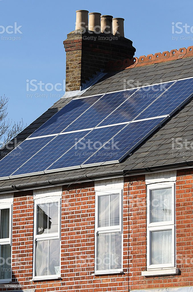 Photoelectric solar panels, domestic, on house roof royalty-free stock photo