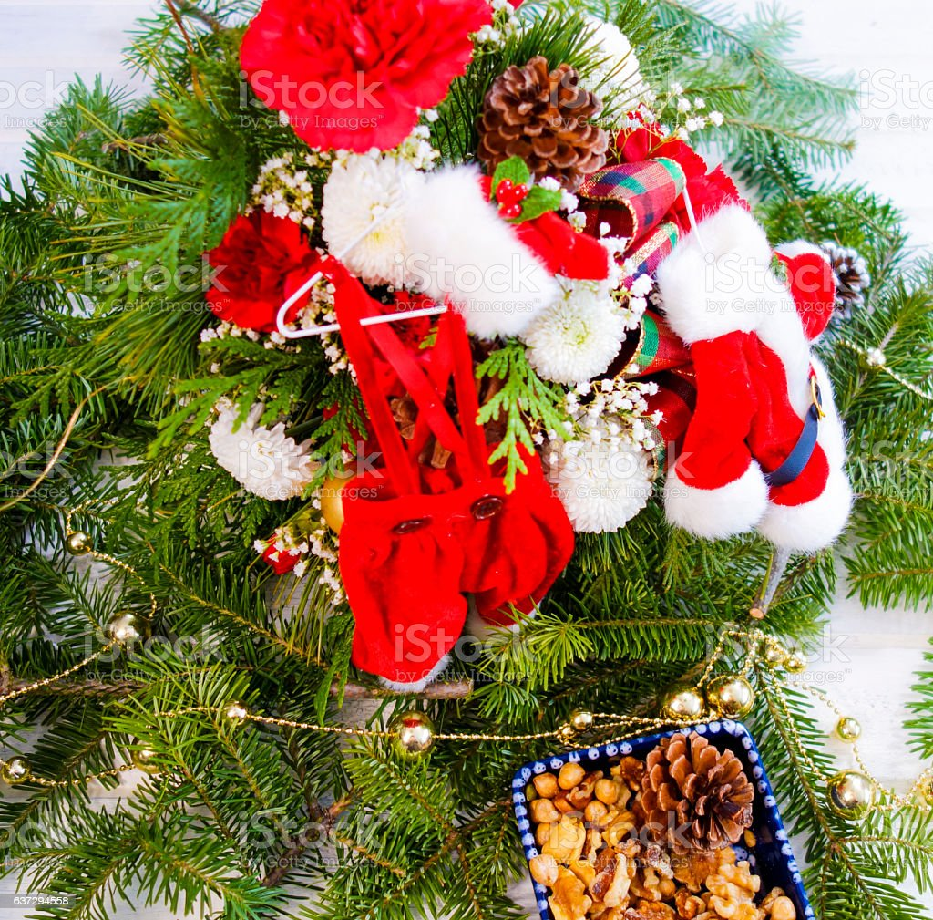 Photograph Christmas Arrangement with Evergreen  and Miniature Santa Outfit stock photo