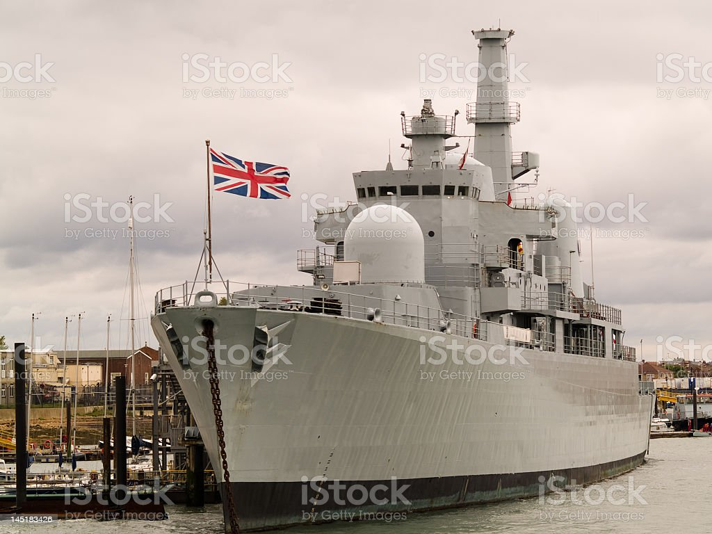Photograph of a British naval ship at port stock photo