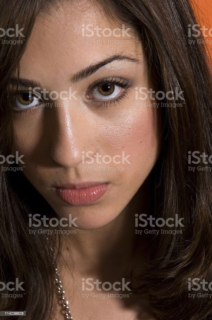 Photograph of a brown haired young woman stock photo