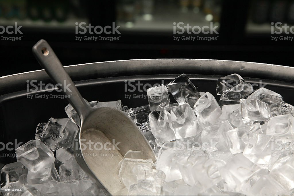 A photograph of a bucket of ice with a trowel royalty-free stock photo