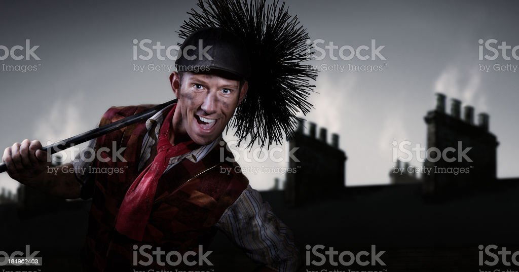 Photograph of a chimney sweep smiling stock photo