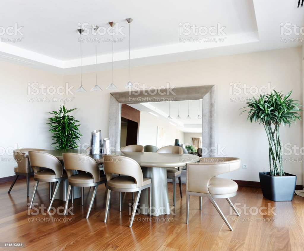 Photograph of a modern dinning room with wood floor royalty-free stock photo