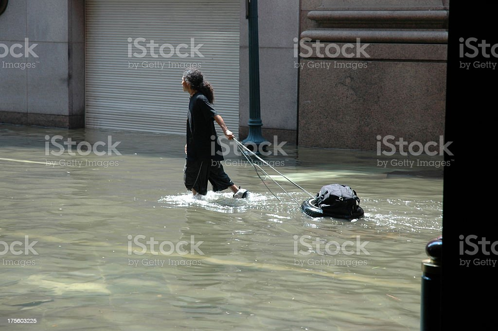 A photograph of a refugees in water stock photo