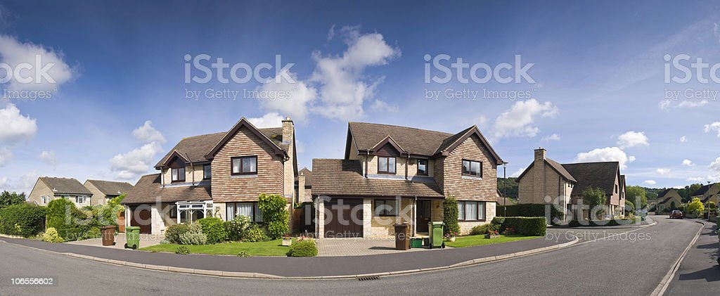 Photograph of a residential street of detached houses stock photo