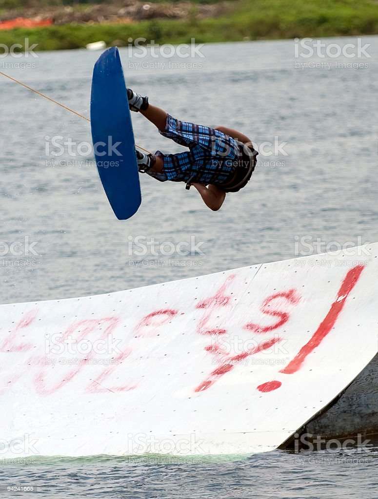 A photograph of a skateboarder jumping on the air stock photo